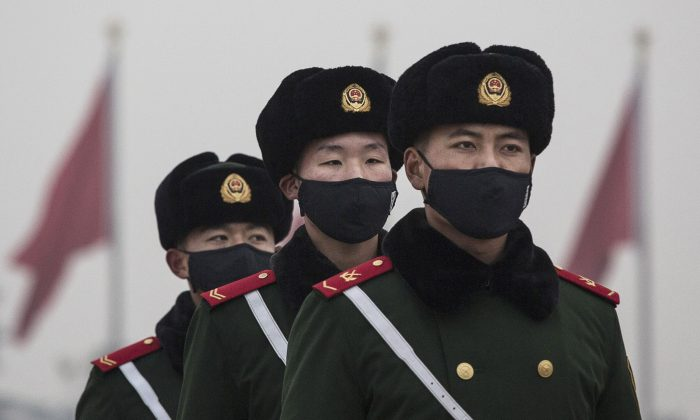 Chinese paramilitary police wear masks in Tiananmen Square on Dec. 9, 2015, in Beijing, China. Chinese state hackers are at the root of recent cyberattacks on the global banking system. (Kevin Frayer/Getty Images)