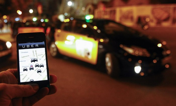 A person hails a car using the Uber app in Sagrada Familia in Barcelona on Dec. 9, 2014.(QUIQUE GARCIA/AFP/Getty Images)