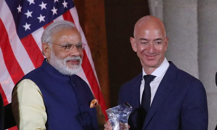 Jeff Bezos, CEO of Amazon,(R), is presented with the 2016 USIBC Global Leadership Award by Indian Prime Minister Narendra Modi during the 41st Annual Leadership Summit at the Mellen Auditorium, June 7, 2016 in Washington, DC. . (Mark Wilson/Getty Images)