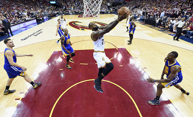 CLEVELAND, OH - JUNE 08: LeBron James #23 of the Cleveland Cavaliers dunks the ball against the Golden State Warriors in Game 3 of the 2016 NBA Finals at Quicken Loans Arena on June 8, 2016 in Cleveland, Ohio. NOTE TO USER: User expressly acknowledges and agrees that, by downloading and or using this photograph, User is consenting to the terms and conditions of the Getty Images License Agreement. (Photo by Bob Donnan - Pool/Getty Images)