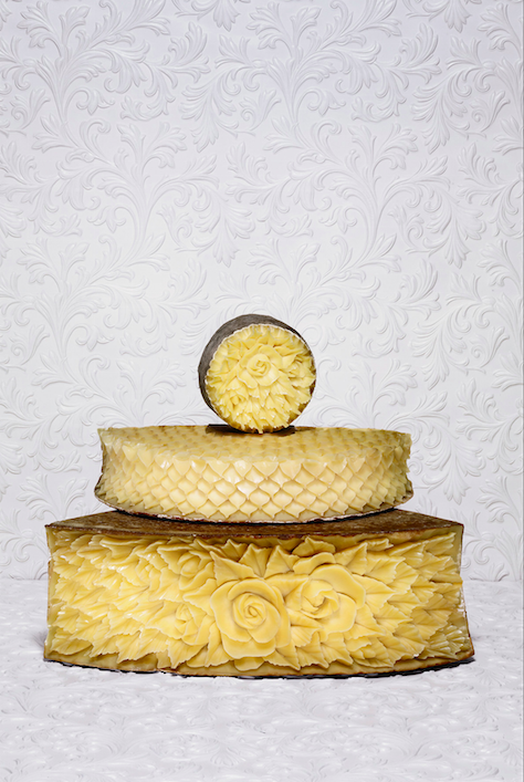 Rococo motifs are carved into cheese as part of the