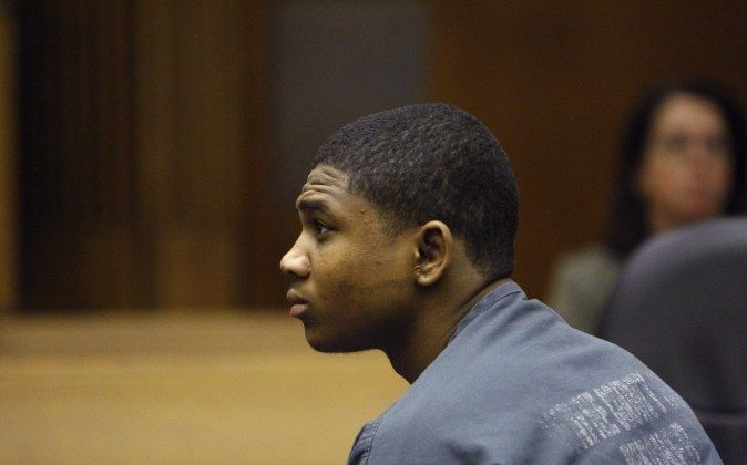 In this June 30, 2010 photo, Davontae Sanford sits in court as attorneys present their findings in Detroit. Sanford was just 14 when he told police he killed four people in a drug den. He was sentenced to at least 38 years in prison for the 2007 slayings, which police say were planned as a robbery but now insists his confession was a lie. (AP Photo/Carlos Osorio)