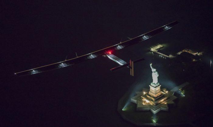 Solar Impulse 2, piloted by Swiss adventurer Andre Borschberg, flies over the Statue of Libery in New York Saturday, June 11, 2016 shortly before landing at John F. Kennedy International Airport. (Jean Revillard/ SI2 via AP)
