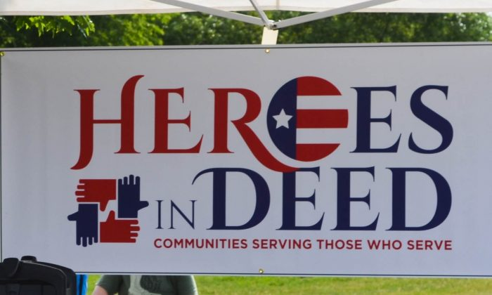 Sign at 2016 Memorial Run for Heroes In Deed fundraiser in Warwick on June 11, 2016. (Yvonne Marcotte/Epoch Times)