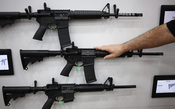 AR-15 rifles are displayed on the exhibit floor during the National Rifle Association (NRA) annual meeting in Louisville, Kentucky, U.S., on Friday, May 20, 2016. The nation's largest gun lobby, the NRA has been a political force in elections since at least 1994, turning out its supporters for candidates who back expanding access to guns. Photographer: Luke Sharrett/Bloomberg