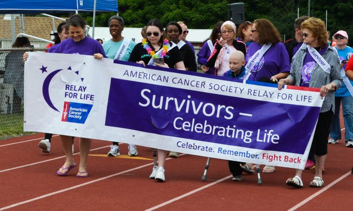 Cancer survivors walk a lap at the American Cancer Society's Relay for Life in Goshen on June 11, 2016. (Yvonne Marcotte/Epoch Times)