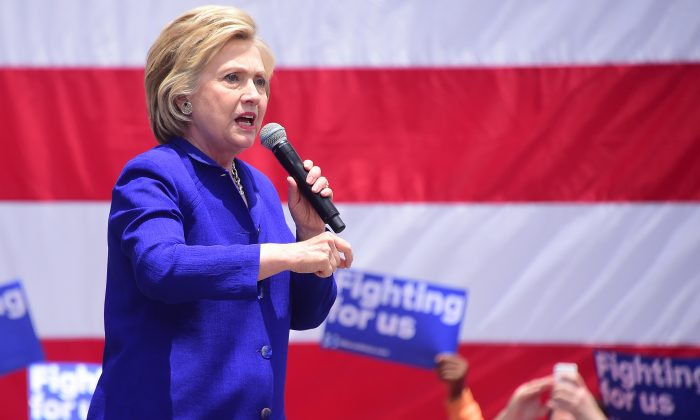 Hillary Clinton speaks to supporters on a last day of Caifornia campaigning on June 6, 2016 in Lynwood, California, where she spoke to supporters at Plaza Mexico. (Photo credit should read FREDERIC J. BROWN/AFP/Getty Images)