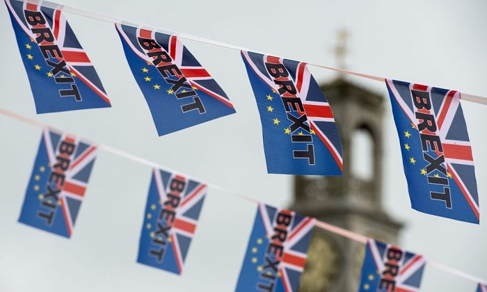 Pro-Brexit flags fly from a fishing boat moored in Ramsgate on June 13, 2016. (Chris J Ratcliffe/AFP/Getty Images)