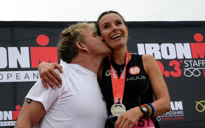 Chef Gordon Ramsay celebrates with his wife Tana after they both finished Ironman 70.3 Staffordshire on June 14, 2015 in Lichfield, England. (Nigel Roddis/Getty Images for Ironman)