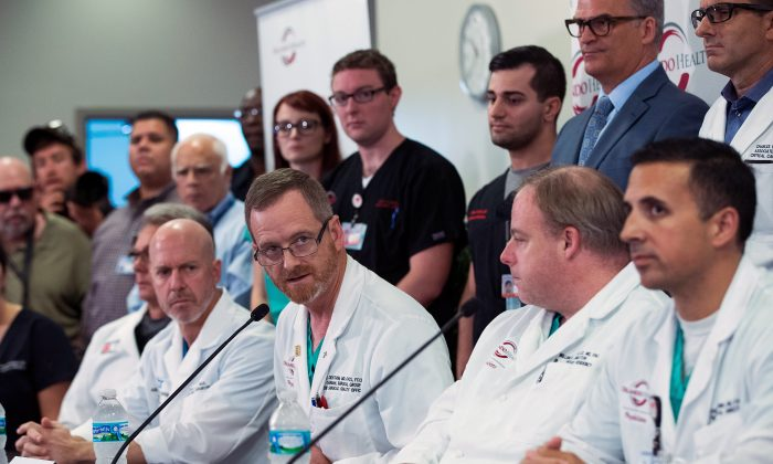 ORLANDO, FL - JUNE 14:  Dr. Michael Cheatham (second from L) speaks during a press conference at Orlando Regional Medical Center, June 14, 2016 in Orlando, Florida. The shooting at Pulse Nightclub, which killed 49 people and injured 53, is the worst mass-shooting event in American history. (Photo by Drew Angerer/Getty Images)
