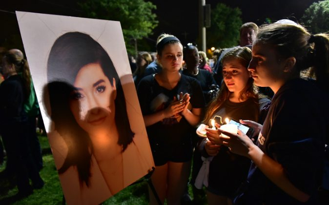 Friends mourn the loss of Christina Grimmie during the Vigil For Christina Grimmie at Evesham Memorial Complex on June 13, 2016 in Evesham, New Jersey. (Brian Killian/Getty Images)