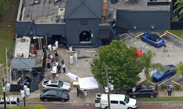 In this Sunday, June 12, 2016 file photo, an aerial view of the mass shooting scene at the Pulse nightclub is seen in Orlando, Fla. A gunman opened fire inside a crowded gay nightclub early Sunday, before dying in a gunfight with SWAT officers, police said. With news that Omar Mateen killed dozens of people in the gay nightclub in Florida and was born to Afghan immigrant parents, the Afghan-American community is expressing horror, sorrow and disbelief that one of their own could commit the worst mass shooting in modern U.S. history. (Red Huber/Orlando Sentinel via AP, File)
