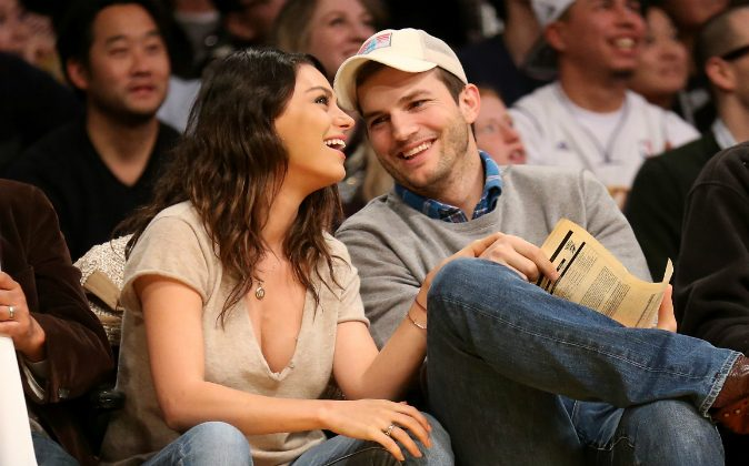 Actors Ashton Kucher and Mila Kunis attend the game between the Oklahoma City Thunder and the Los Angeles Lakers at Staples Center on December 19, 2014 in Los Angeles, California. (Stephen Dunn/Getty Images)