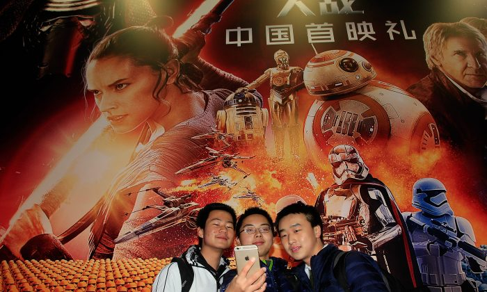 "Fans attend the premiere of ""Star Wars: The Force Awakens,"" in Shanghai on Dec. 27, 2015. (Hu Chengwei/Getty Images for Walt Disney Studios)"