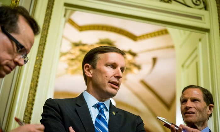 Senator Chris Murphy (D-CT) speaks to reporters after waging an almost 15-hour filibuster on the Senate floor in order to force a vote on gun control on June 15, 2016 in Washington, DC. (Pete Marovich/Getty Images)