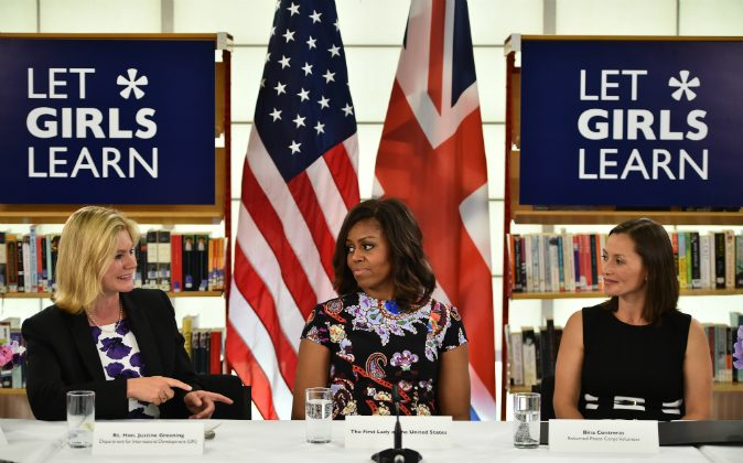 US First Lady Michelle Obama (C) sits between The UK Department of International Development's Justine Greening and (L) returned Peace Corps Volunteer Bina Contreras (R) during a 'Let Girls Learn' meeting as part of the 'Let Girls Learn Initiative' at the Mulberry School for Girls on June 16, 2015 in London, England. (Jeff J Mitchell/Getty Images)