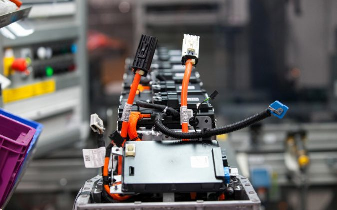 Cables and lithium-ion battery components sit on the production line at the Bayerische Motoren Werke AG (BMW) automobile manufacturing plant in Dingolfing, Germany, on Thursday, Aug. 21, 2014. Photographer: Krisztian Bocsi/Bloomberg via Getty Images