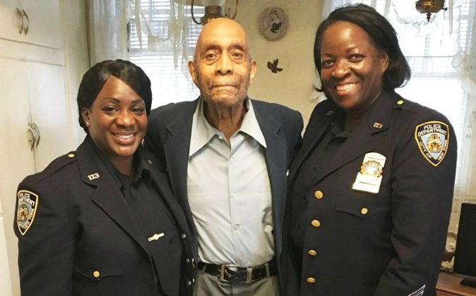 Detective Ferguson, from left, William Brown and Detective Tanya Duhaney at Brown's home in St. Albans, Queens. (NYPD)