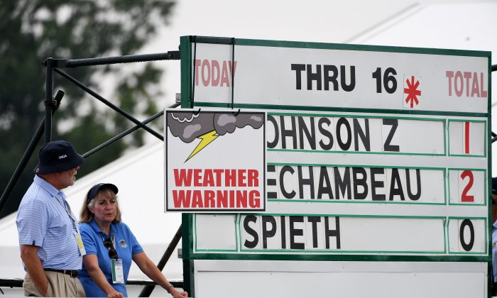A weather delay sign is seen on the leader board during the first round of the U.S. Open at Oakmont Country Club on June 16 in Oakmont, Pennsylvania. (Ross Kinnaird/Getty Images)