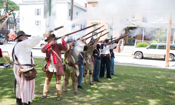 Reenactors fire guns at the Art & History in the Park in Port Jervis on June 18, 2016. (Holly Kellum/Epoch Times)
