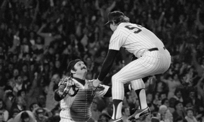 New York Yankees closer Goose Gossage (R) leaps into the arms of catcher Thurman Munson after beating the Kansas City Royals 2–1 in Game 4 to win the ALCS. (AP Photo/Richard Drew)