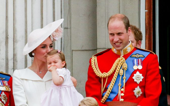LONDON, ENGLAND - JUNE 11: Catherine, Duchess of Cambridge, Princess Charlotte, Prince George and Prince William, Duke of Cambridge stand on the balcony during the Trooping the Colour. (Luca Teuchmann/WireImage)