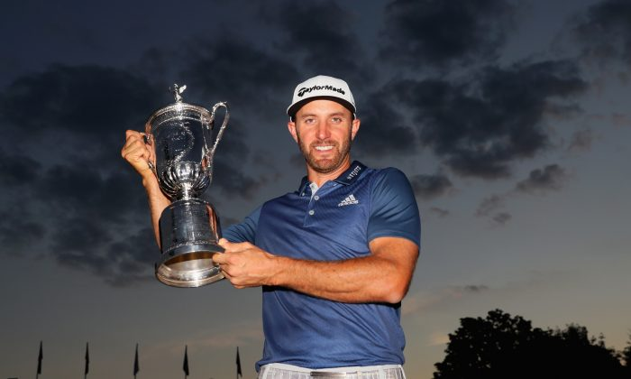 Dustin Johnson poses with the winner's trophy after winning the U.S. Open at Oakmont Country Club on June 19 in Oakmont, Pennsylvania. (Andrew Redington/Getty Images)