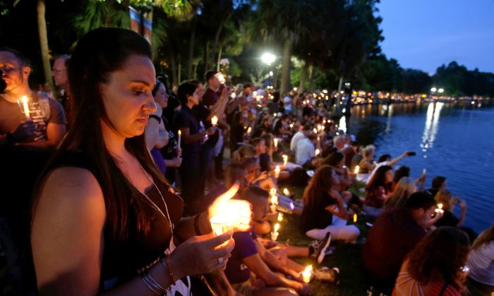 Supporters of the victims of the recent mass shooting at the Pulse nightclub attend a vigil at Lake Eola Park, in Orlando, Fla., on June 19. Tens of thousands of people attended the vigil. (AP Photo/John Raoux)