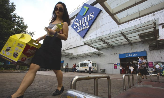 A woman walks out from a Sam's Club in Shenzhen, in southern China's Guangdong province, on Nov. 15, 2015. (AP Photo/Ng Han Guan)