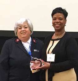 (L-R) Lt. Col. Ardis Fuga gives the Salvation Army Award to Paula Coppin, operating supervisor of Consumer Outreach, for Central Gas & Electric, Inc. during the National Energy Utility and Affordability conference in Denver, Colo. in June. (courtesy Central Hudson Utility)
