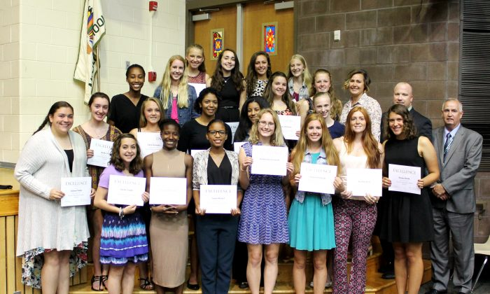 Minisink Valley's girls track and field varsity team are joined by (Back row, R-L) Board president Joseph Flaherty, Director of Athletics Tim Bult, and the team's head coach Kara Anderson-Winchell (courtesy  Minisink Valley Central School District)