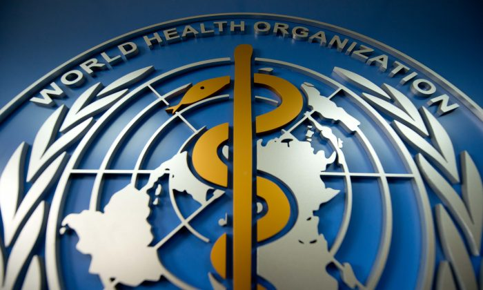A World Health Organization (WHO) logo at their office in Beijing on April 19, 2013. (Ed Jones/AFP/Getty Images)