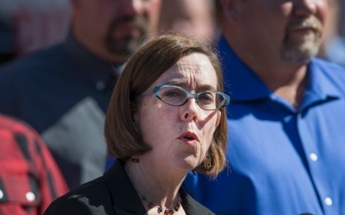 Oregon governor Kate Brown speaks to the press about the mass shooting at Umpqua Community College on October 2, 2015 in Roseburg, Oregon. (Photo by Scott Olson/Getty Images)