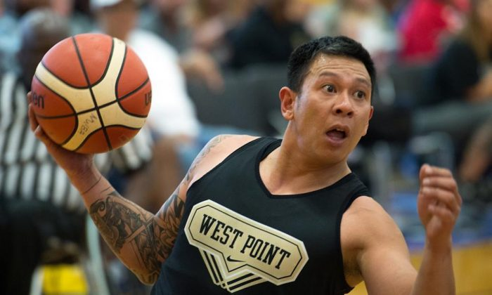 Army veteran Sgt. Jhoonar Barrera looks to pass the ball during the gold medal round of basketball for the 2016 DoD Warrior Games at West Point on June 21, 2016. (courtesy DoD, EJ Hersom)