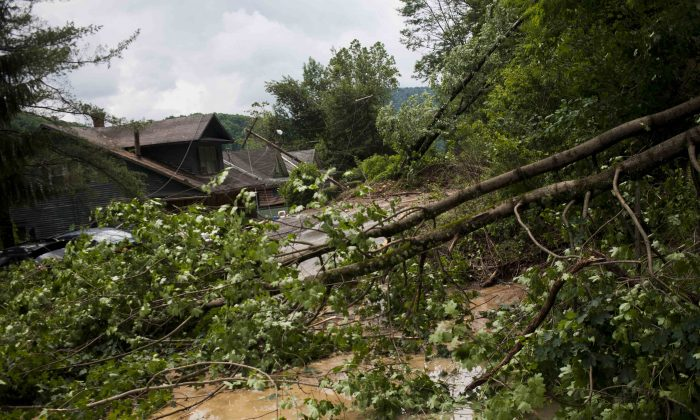 Rock, mud, trees, downed power lines and other debris litter the road on Main Street leading into Richwood, W.Va. after severe flooding and multiple rockslides on Friday June 24, 2016. (Christian Tyler Randolph/Charleston Gazette-Mail via AP) MANDATORY CREDIT)