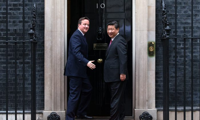 U.K. Prime Minister David Cameron (L) and Chinese Leader Xi Jinping arrive at 10 Downing Street in London on Oct. 21, 2015. With Britain's exit from the EU, China loses its chief ally in Europe. (Carl Court/Getty Images)