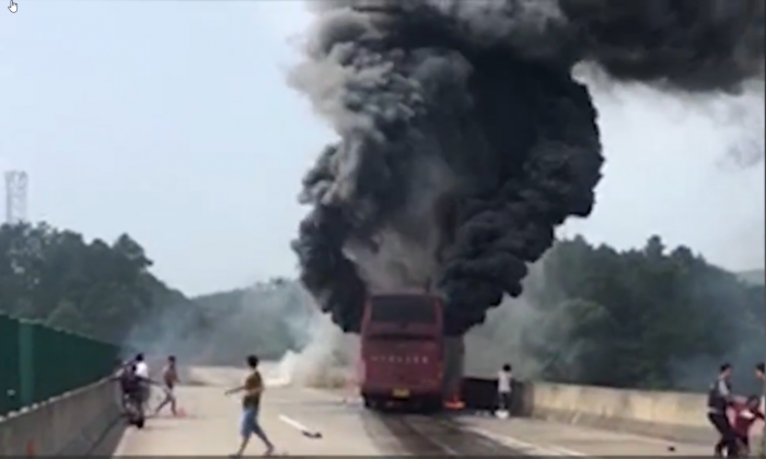 Thick smoke emerging from the bus