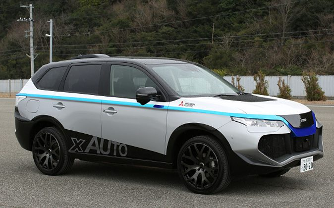 A Mitsubishi Electric Corp. self-driving vehicle stands in a test course during a demonstration in Ako, Hyogo Prefecture, Japan, on Friday, March 18, 2016. Mitsubishi Electric Corp., a supplier of air-to-air missiles to Japan's armed forces, is looking to adapt the technologies it originally developed for military use to help autonomous driving cars detect obstacles and avoid collisions. Photographer: Buddhika Weerasinghe/Bloomberg