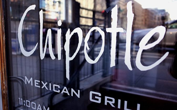 The Chipotle logo is seen on the door of one of its restaurants in Washington on Jan. 11, 2015. The embattled Mexican fast food chain is under increased scrutiny following outbreaks of foodborn illnesses which lead a decline in share prices. (Mandel Ngan/AFP/Getty Images)
