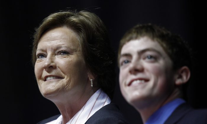FILE - In this April 19, 2012, file photo, former Tennessee women's college basketball coach Pat Summitt appears at a news conference with her son Tyler Summitt, right, in Knoxville, Tenn.  Pat Summitt's rich legacy in women's basketball can be seen on the sidelines and in front offices throughout the college and professional ranks. At the time Summitt ended her illustrious, 38-season coaching career at Tennessee in 2012, 78 people who were mentored by her were coaching basketball or working in administrative positions associated with the game. Summitt died Tuesday morning, June 28, 2016. She was 64.(AP Photo/Wade Payne, FIle)