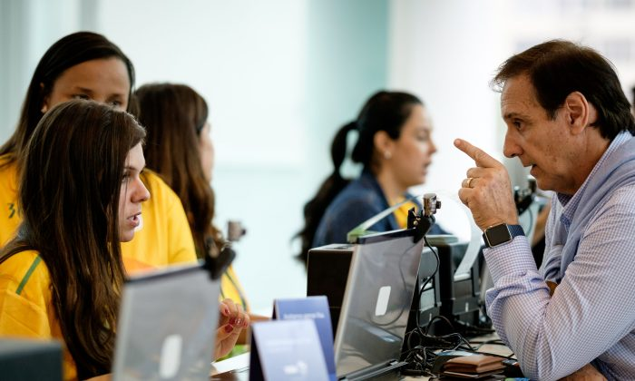 An Argentine gets tickets for the Olympic games at the Shopping Leblon mall in Rio de Janeiro on June 20. (YASUYOSHI CHIBA/AFP/Getty Images)