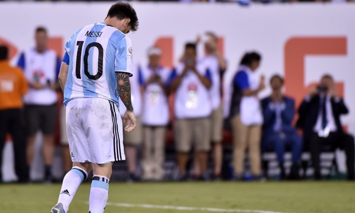 Argentina's Lionel Messi shows his dejection after being defeated by Chile in the Copa America Centenario final in East Rutherford, New Jersey, United States, on June 26, (Nelson Almeida/AFP/Getty Images)