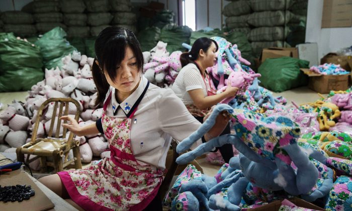 Chinese workers prepare stuffed toys at a factory in  Zhejiang, China, September 17, 2015  (Kevin Frayer/Getty Images)