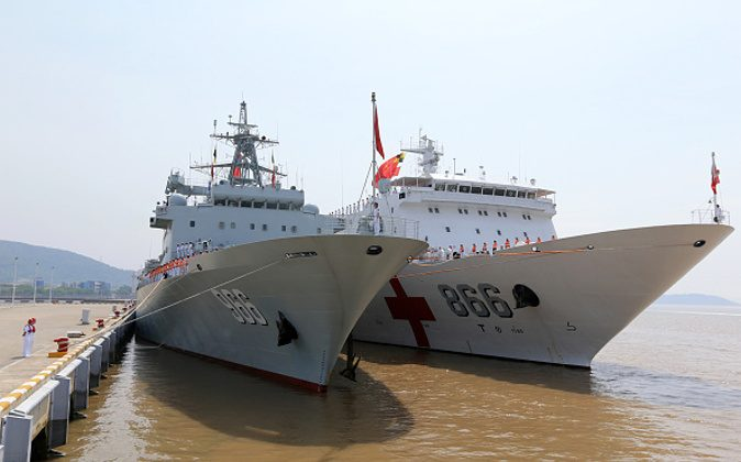 ZHOUSHAN, CHINA - JUNE 15: (CHINA OUT) The supply ship Gaoyouhu and the hospital ship Peace Ark are gonging to set sail to Hawaii to join 2016 Pacific Rim (RIMPAC) on June 15, 2016 in Zhoushan, Zhejiang Province of China. It was the second time that Chinese navy had participated in RIMPAC. According to schedules, the Chinese navy fleet would meet the United States Navy at the western Pacific Ocean on Saturday. Then the two countries' navy would leave for Pearl Harbor, Hawaii. (Photo by Li Tang/CNSPHOTO/VCG via Getty Images)