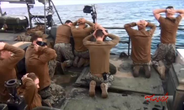 This picture released by the Iranian state-run IRIB News Agency on Wednesday, Jan. 13, 2016, shows detention of American Navy sailors by the Iranian Revolutionary Guards in the Persian Gulf, Iran. Iranian state television is reporting that all 10 U.S. sailors detained by Iran after entering its territorial waters have been released. Iran's Revolutionary Guard said the sailors were released Wednesday after it was determined that their entry was not intentional. (Sepahnews via AP)