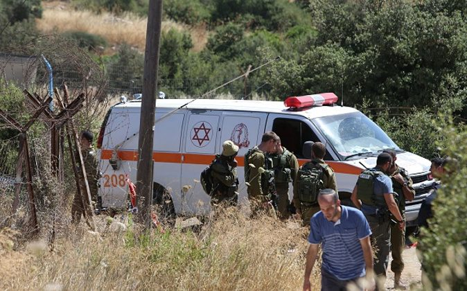 An Israeli ambulance and soldiers are seen outside a house in the Jewish settlement of Kiryat Arba in the occupied West Bank where a 13-year-old Israeli girl was fatally stabbed in her bedroom on June 30, 2016. A Palestinian attacker stabbed a 13-year-old girl to death at her home in the Jewish settlement outside the city of Hebron before being shot dead by security guards, the Israeli army said. / AFP / MENAHEM KAHANA (Photo credit should read MENAHEM KAHANA/AFP/Getty Images)