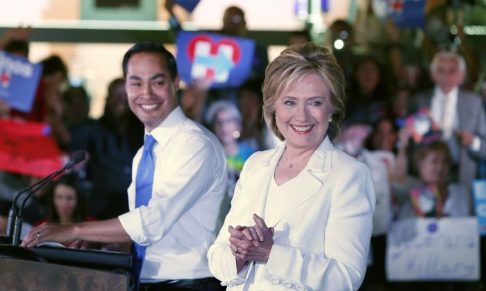 """Secretary of Housing and Urban Development Secretary Julian Castro introduces Democratic presidential candidate Hillary Clinton at a """"Latinos for Hillary"""" grassroots event October 15, 2015 in San Antonio, Texas.  (Photo by Erich Schlegel/Getty Images)"""