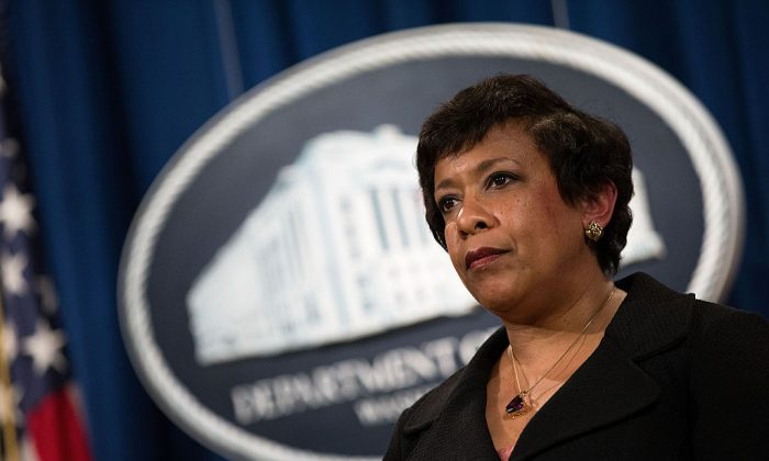 WASHINGTON, DC - MAY 9: U.S. Attorney General Loretta Lynch looks on after announcing federal action related to North Carolina, at the U.S. Department of Justice, May 9, 2016, in Washington, DC. Led by Governor Pat McCrory, North Carolina officials sued the U.S. Justice Department on Monday for challenging the state's law on public restroom access. Last week, the Justice Department stated that North Carolina violated the Civil Rights Act of 1964 by prohibiting people from using public restrooms that do not match the gender listed on their birth certificates. Governor McCrory, a Republican, has called the Justice Department's stance on the issue 'baseless and blatant overreach.' (Photo by Drew Angerer/Getty Images)