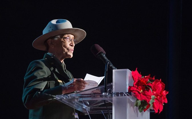 Betty Reid Soskin, at 94 the oldest National Park Service Ranger in the United States, speaks on the Ellipse of the National Mall December 3, 2015 in Washington, DC. The First Family was joined by celebrities and guests to light the National Christmas tree during an evening of performances. AFP PHOTO / JIM WATSON / AFP / JIM WATSON (Photo credit should read JIM WATSON/AFP/Getty Images)