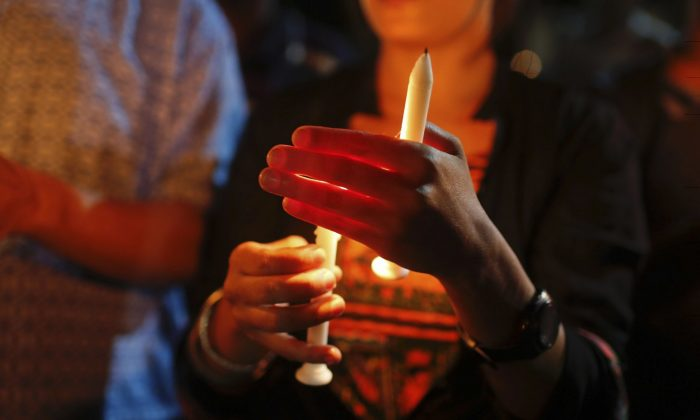 Bangladeshis light candles as they pay tribute to those killed in the attack at the Holey Artisan Bakery in Dhaka, Bangladesh, Sunday, July 3, 2016. The assault on the restaurant in Dhaka's diplomatic zone by militants who took dozens of people hostage marks an escalation in militant violence in the Muslim-majority nation. (AP Photo)